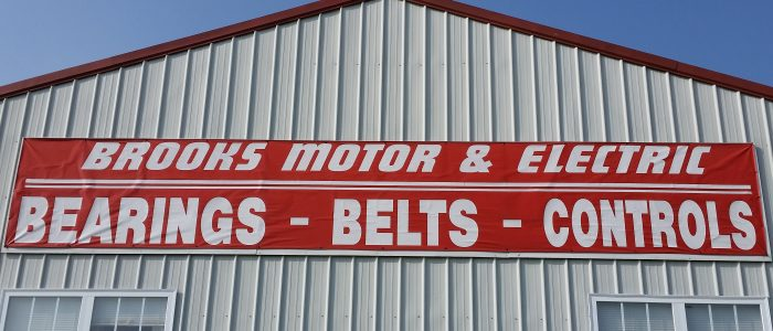 Red banner that says Brooks Motor & Electric - Bearings - Belts - Controls